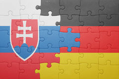 Puzzle with the national flag of slovakia and germany. Concept Royalty Free Stock Photography