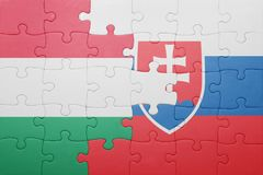 Puzzle with the national flag of slovakia and hungary. Concept stock photo