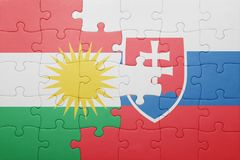 Puzzle with the national flag of slovakia and kurdistan. Concept Royalty Free Stock Image