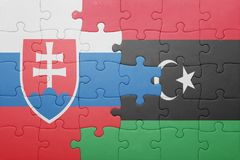 puzzle with the national flag of slovakia and libya Stock Image