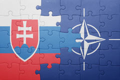 Puzzle with the national flag of slovakia and nato. Concept stock photography