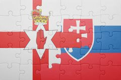 Puzzle with the national flag of slovakia and northern ireland. Concept royalty free stock images