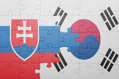 Puzzle with the national flag of slovakia and south korea. Concept royalty free stock photos