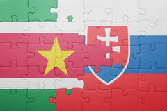 Puzzle with the national flag of slovakia and suriname. Concept Royalty Free Stock Photo