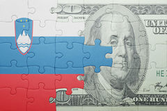Puzzle with the national flag of slovenia and dollar banknote. Concept Stock Photography