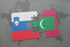 Puzzle with the national flag of slovenia and maldives on a world map Stock Image