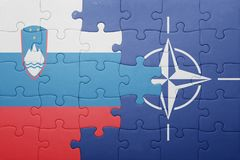 Puzzle with the national flag of slovenia and nato. Concept stock photography