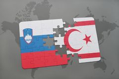 Puzzle with the national flag of slovenia and northern cyprus on a world map Royalty Free Stock Images