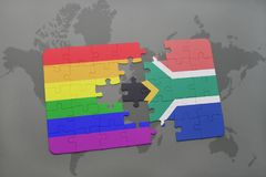Puzzle with the national flag of south africa and gay rainbow flag on a world map background. Royalty Free Stock Images