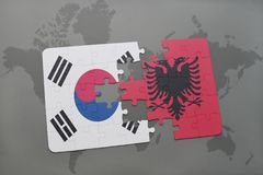 Puzzle with the national flag of south korea and albania on a world map background. 3D illustration stock photography