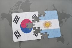 Puzzle with the national flag of south korea and argentina on a world map background. Royalty Free Stock Photography