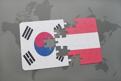 Puzzle with the national flag of south korea and austria on a world map background. 3D illustration Royalty Free Stock Photography