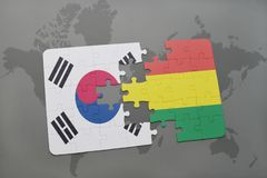 Puzzle with the national flag of south korea and bolivia on a world map background. 3D illustration royalty free stock photography