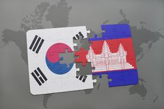 puzzle with the national flag of south korea and cambodia on a world map background. Stock Images