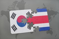 Puzzle with the national flag of south korea and costa rica on a world map background. 3D illustration royalty free stock image