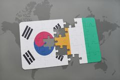 Puzzle with the national flag of south korea and cote divoire on a world map background. 3D illustration Stock Photos
