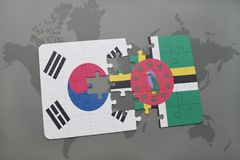 Puzzle with the national flag of south korea and dominica on a world map background. 3D illustration stock photo