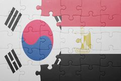 Puzzle with the national flag of south korea and egypt. Concept royalty free stock photo