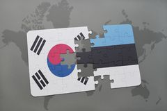 Puzzle with the national flag of south korea and estonia on a world map background. 3D illustration royalty free stock image