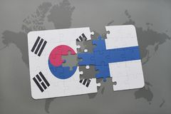 Puzzle with the national flag of south korea and finland on a world map background. 3D illustration stock photography