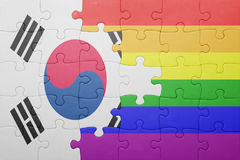 Puzzle with the national flag of south korea and gay flag. Concept royalty free stock images