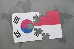 Puzzle with the national flag of south korea and indonesia on a world map background. 3D illustration Royalty Free Stock Image
