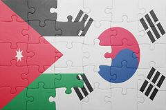 Puzzle with the national flag of south korea and jordan. Concept stock images