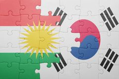 Puzzle with the national flag of south korea and kurdistan. Concept stock photography
