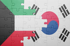 Puzzle with the national flag of south korea and kuwait. Concept royalty free stock image