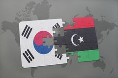 Puzzle with the national flag of south korea and libya on a world map background. 3D illustration stock photography