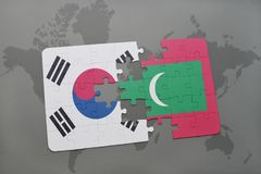 Puzzle with the national flag of south korea and maldives on a world map background. Stock Photography