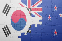 Puzzle with the national flag of south korea and new zealand. Concept stock photography