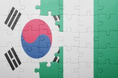 Puzzle with the national flag of south korea and nigeria. Concept stock images