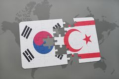 Puzzle with the national flag of south korea and northern cyprus on a world map background. Royalty Free Stock Photos