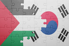 Puzzle with the national flag of south korea and palestine. Concept royalty free stock photo