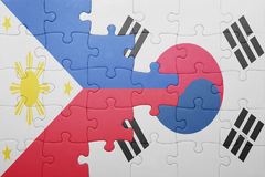 Puzzle with the national flag of south korea and philippines. Concept stock photos