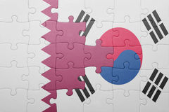 Puzzle with the national flag of south korea and qatar. Concept stock image