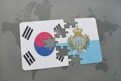Puzzle with the national flag of south korea and san marino on a world map background. Royalty Free Stock Image