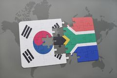 Puzzle with the national flag of south korea and south africa on a world map background. Royalty Free Stock Images