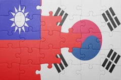 Puzzle with the national flag of south korea and taiwan. Concept royalty free stock photography