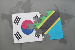 Puzzle with the national flag of south korea and tanzania on a world map background. 3D illustration stock photography