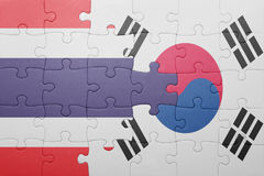 Puzzle with the national flag of south korea and thailand. Concept royalty free stock images