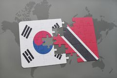 Puzzle with the national flag of south korea and trinidad and tobago on a world map background. 3D illustration Royalty Free Stock Photos