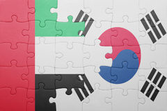 Puzzle with the national flag of south korea and united arab emirates. Concept stock photo