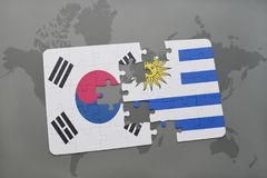 Puzzle with the national flag of south korea and uruguay on a world map background. 3D illustration royalty free stock photography