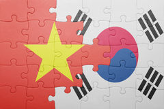 Puzzle with the national flag of south korea and vietnam. Concept royalty free stock photo