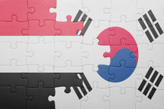 Puzzle with the national flag of south korea and yemen. Concept royalty free stock photography