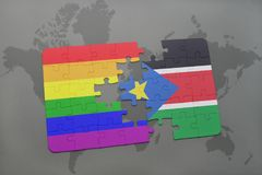 puzzle with the national flag of south sudan and gay rainbow flag on a world map background. Royalty Free Stock Photo