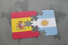 Puzzle with the national flag of spain and argentina on a world map background. Stock Photos