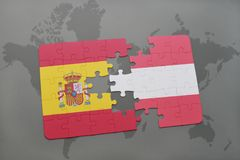 Puzzle with the national flag of spain and austria on a world map background. 3D illustration Royalty Free Stock Images